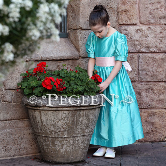 Our customer chose this Tiffany Blue and Peony Pink silk flower girl dress for her photo shoot at Disney World